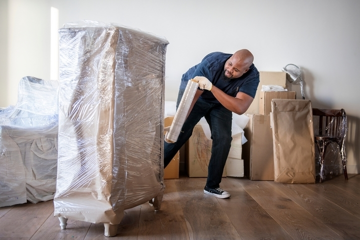 Cover your bulky furniture when moving in bad weather.