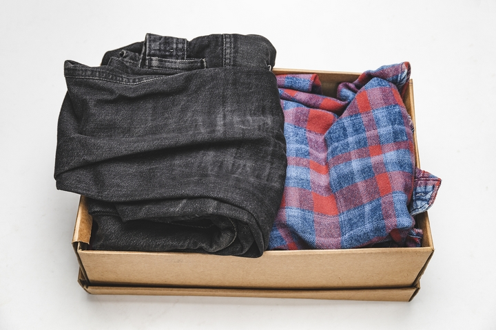 Pack your clothes into small boxes.